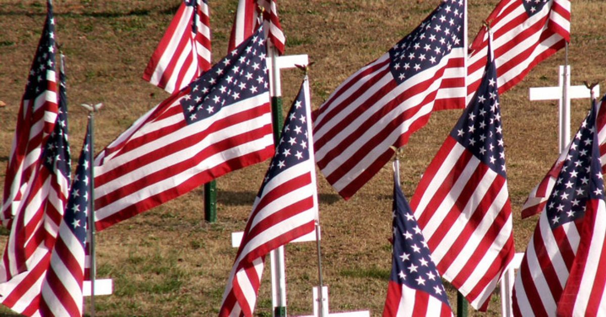american flags standing in the ground