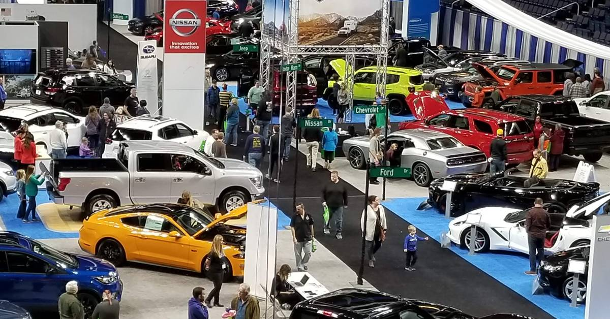overhead view of people at an indoor auto show