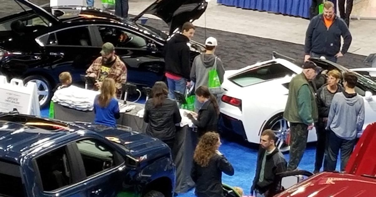 view of people browsing an auto show