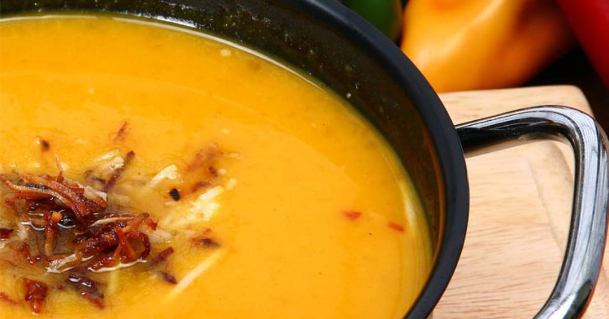 close up of squash soup with a dollup of bacon