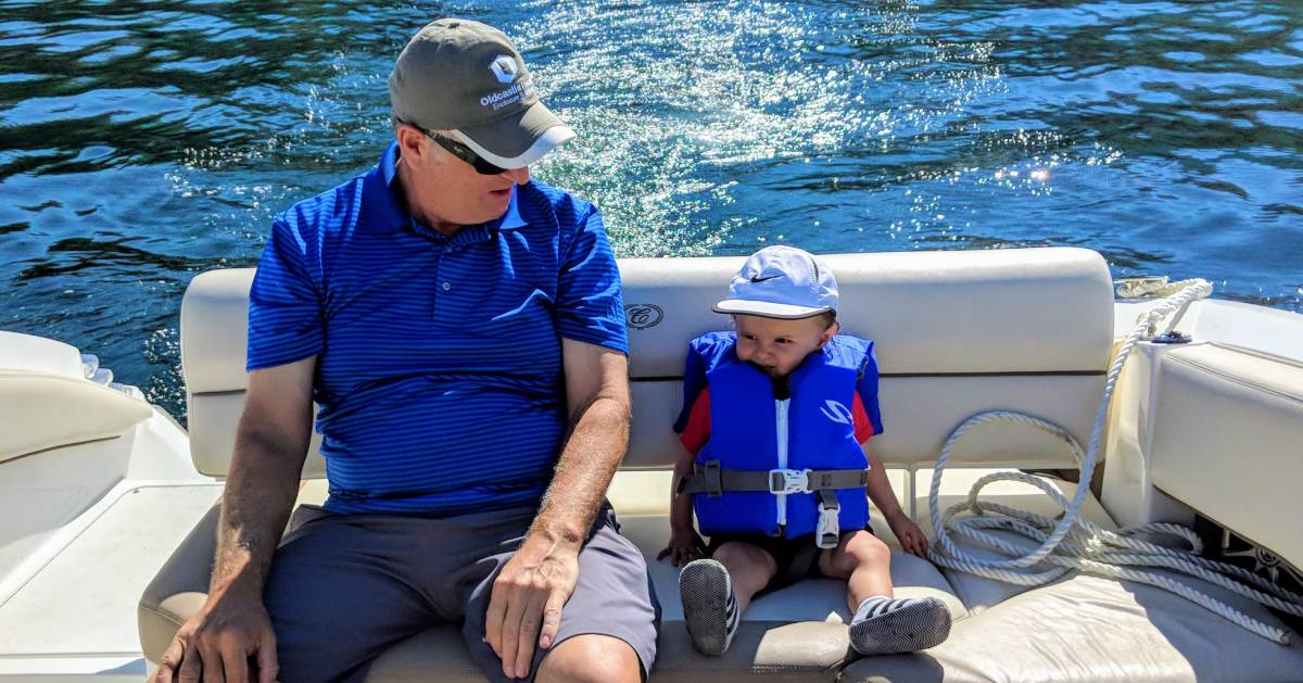 grandfather and toddler on boat