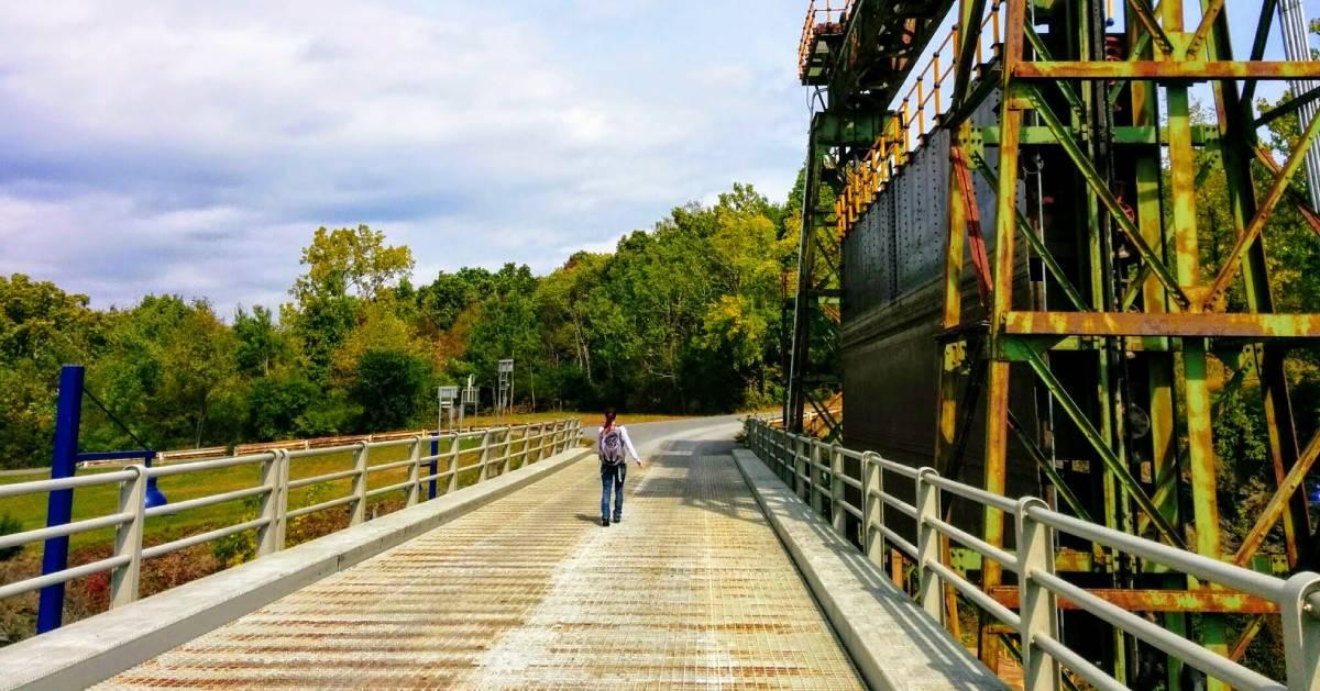 woman walking along path by canal
