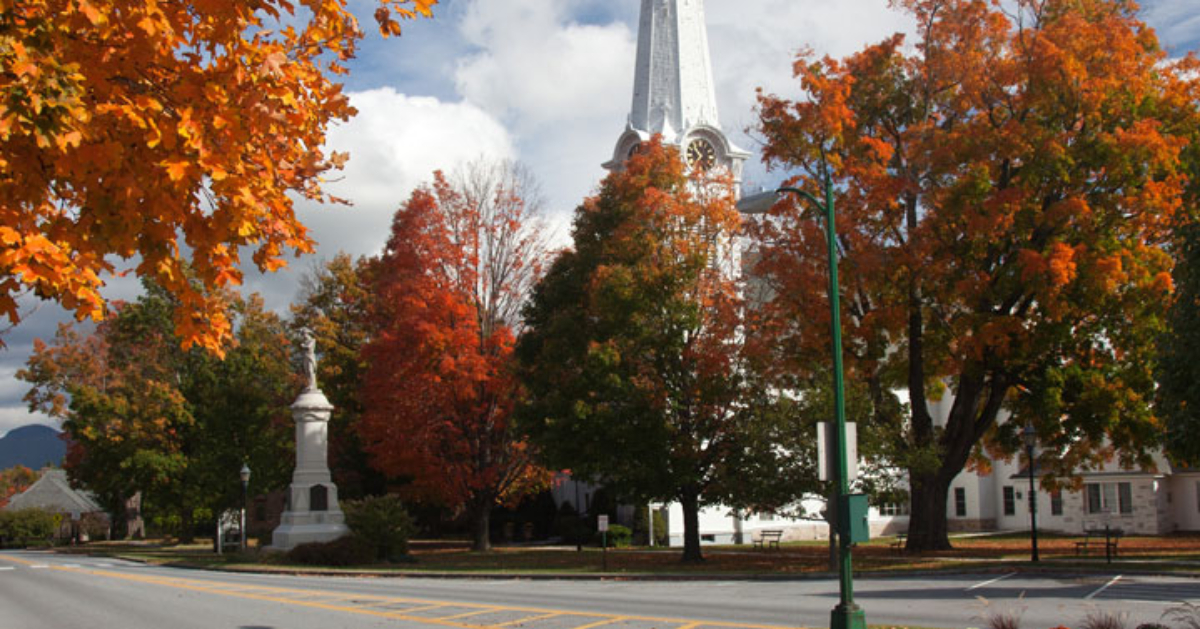 a church in Manchester with beautiful orange and red fall foliage on trees surrounding it