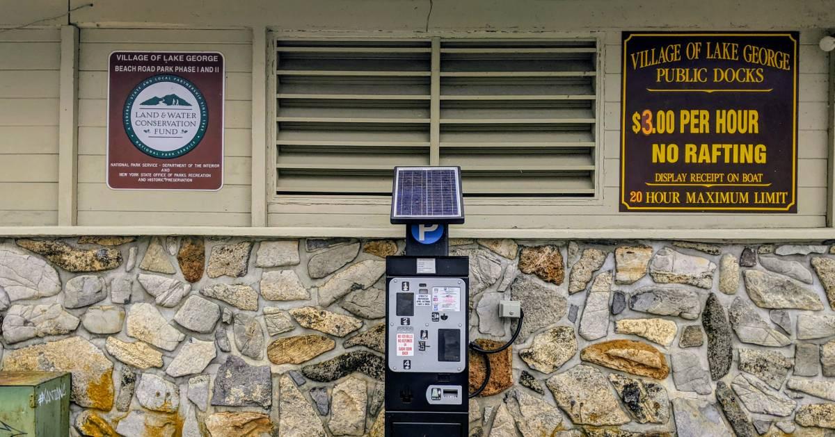 Village dock parking sign and parking meter