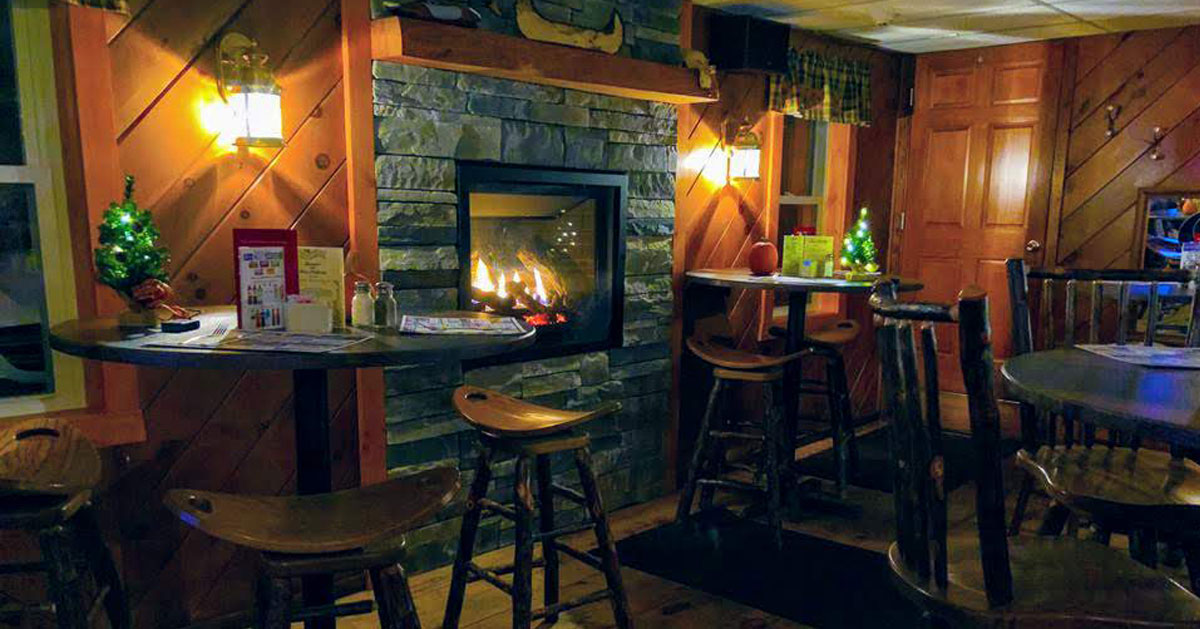 a restaurant with a fire in the fireplace