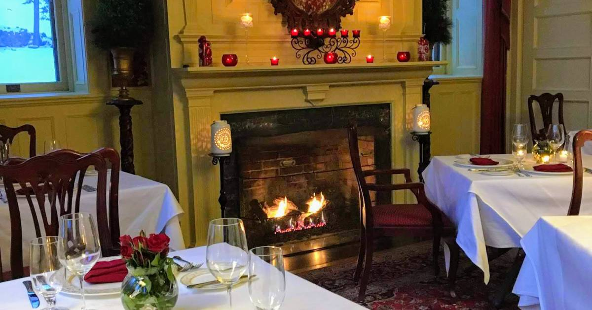 fireplace in dining room with Valentine's Day decorations