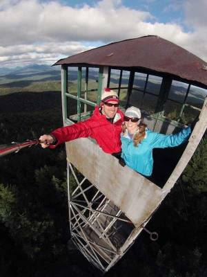 couple in fire tower takes selfie with selfie stick