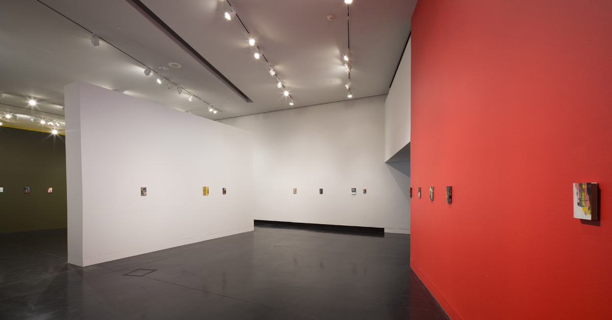art gallery with red and white walls