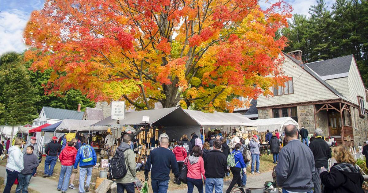 garage sale and tree with fall foliage