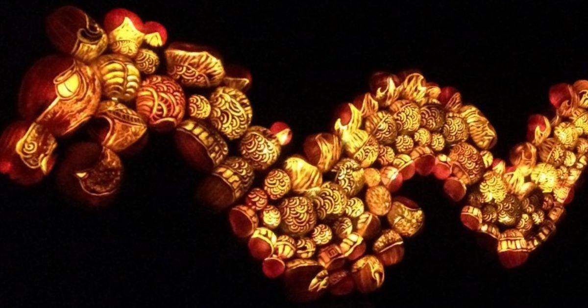 illuminated jack o lanterns in the shape of a dragon