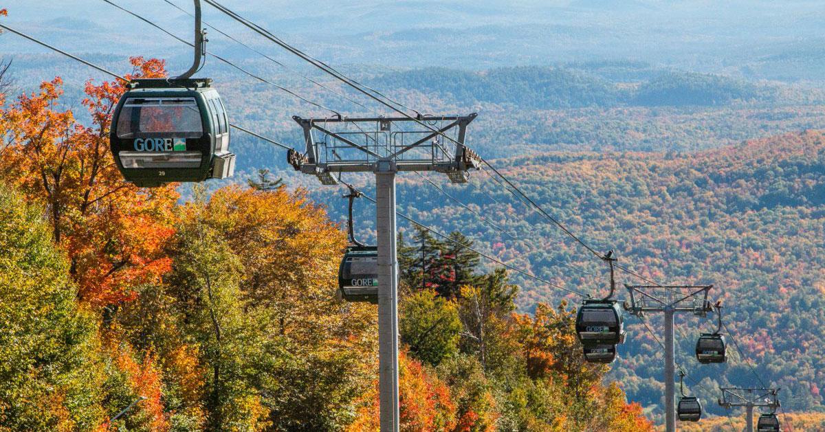 Gondolas ascending Gore Mountain in autumn