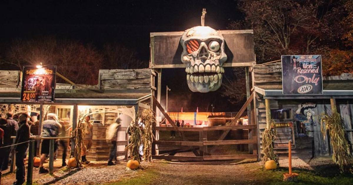 giant skull above entrance to a haunted hayride