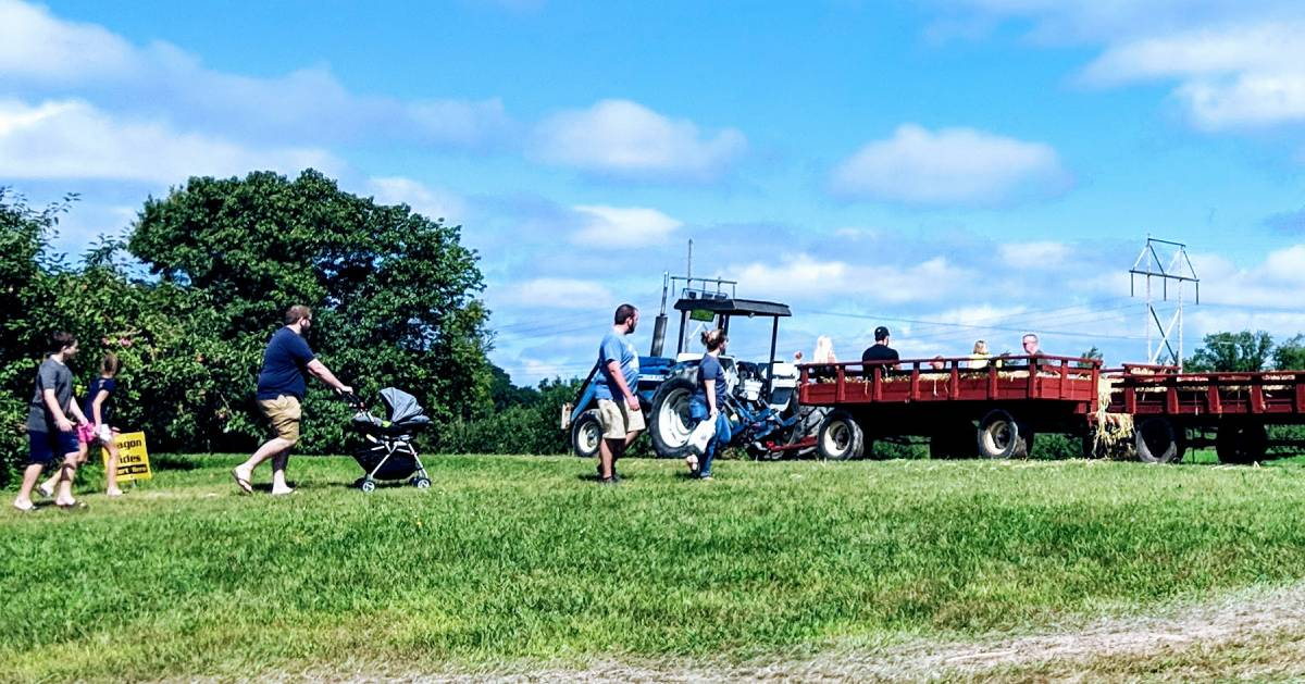 people getting onto a hayride