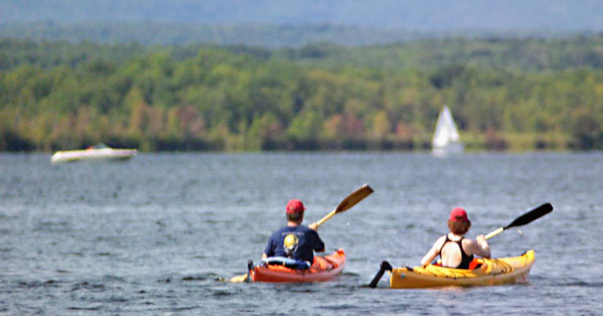 two kayakers on the water in the fall