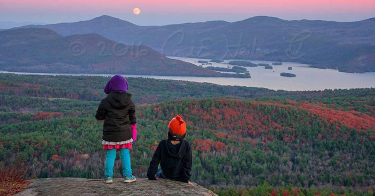 two kids on mountain summit