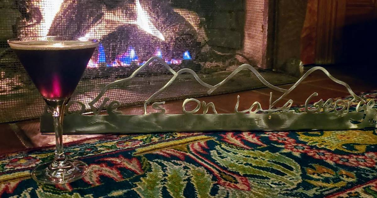 martini by Love is on Lake George trinket in front of fire
