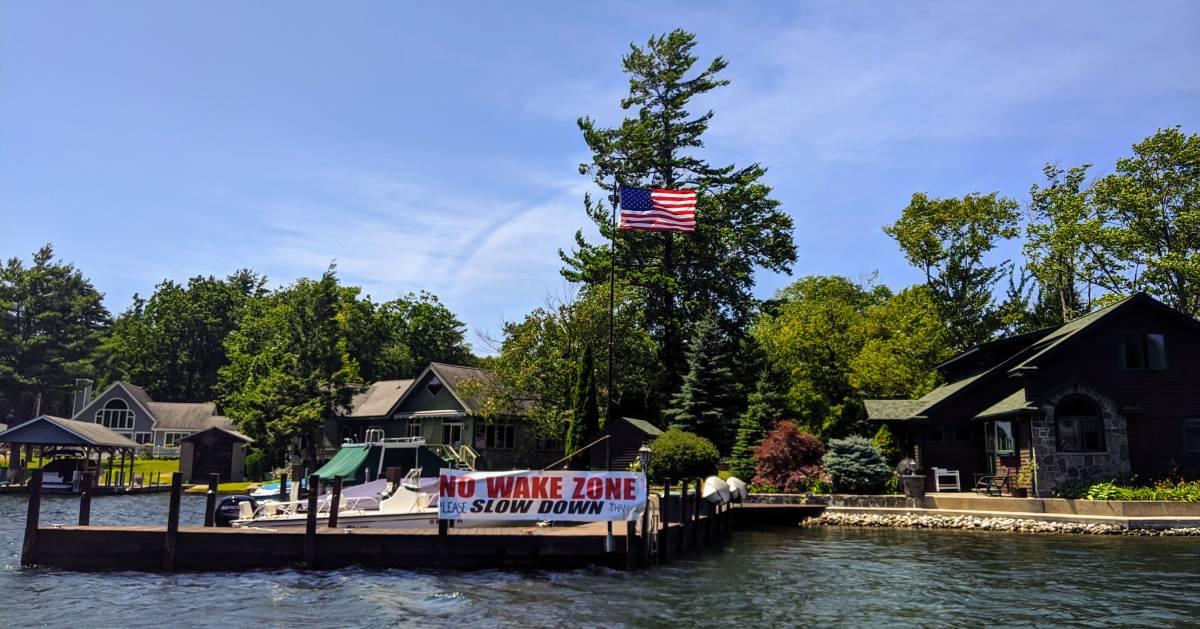 no wake zone slow down sign