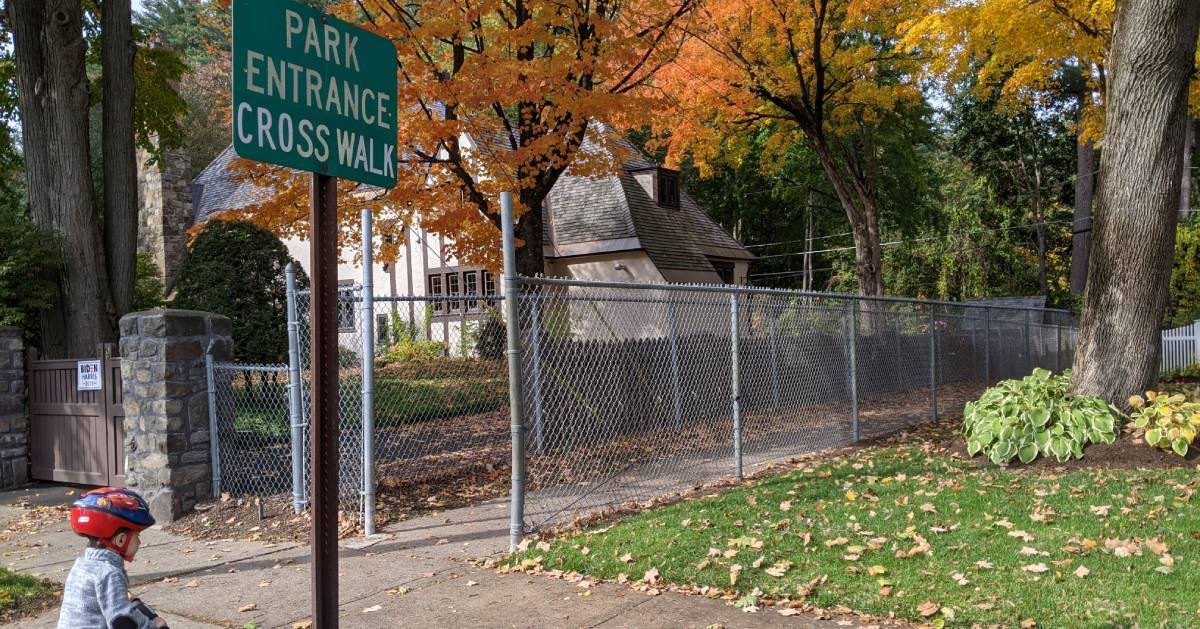 park entrance crosswalk sign in fall