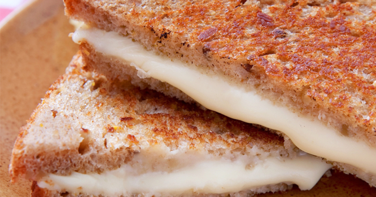 close up of a stacked grilled cheese sandwich