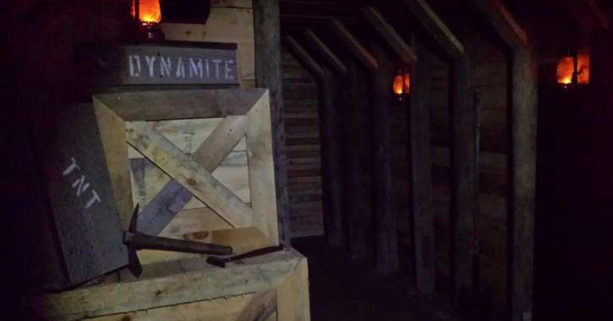 a creepy dark room with a box that says dynamite