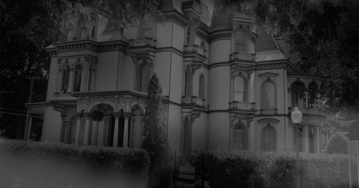 black and white photo of spooky mansion