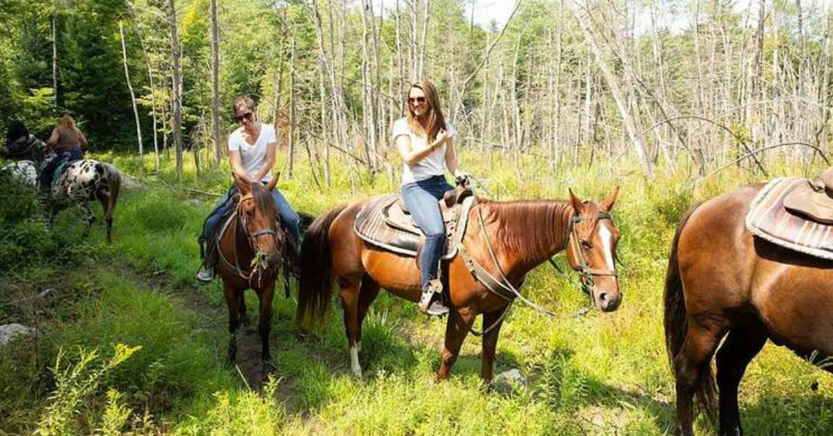 two women on a riding trail