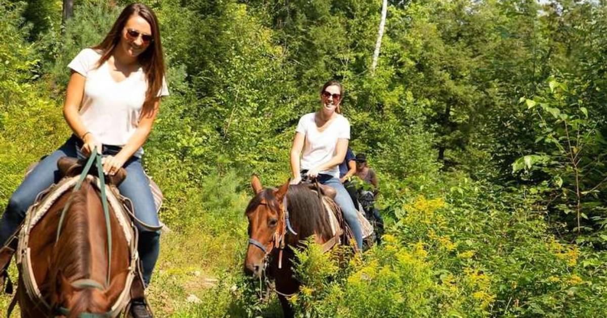 two young women horseback riding