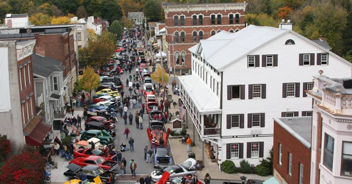 aerial view of a car show in a downtown street