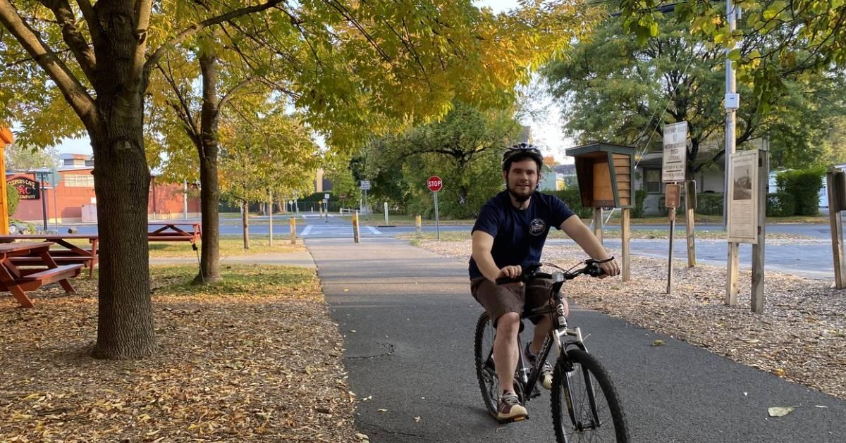 man on bike on bike path in fall