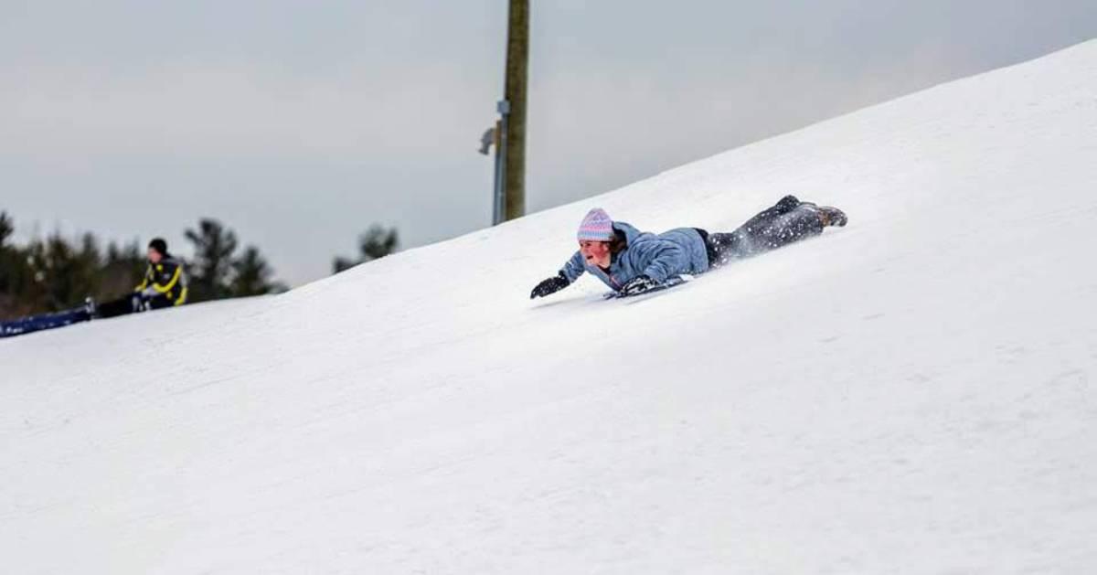a girl sleds