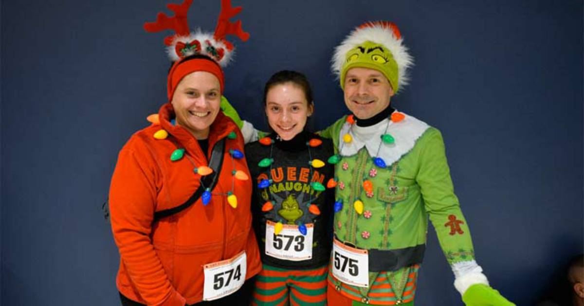 three people wearing holiday themed running attire