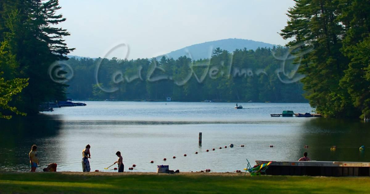 kids playing by a lake