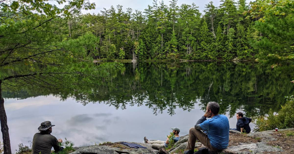 hikers resting by water
