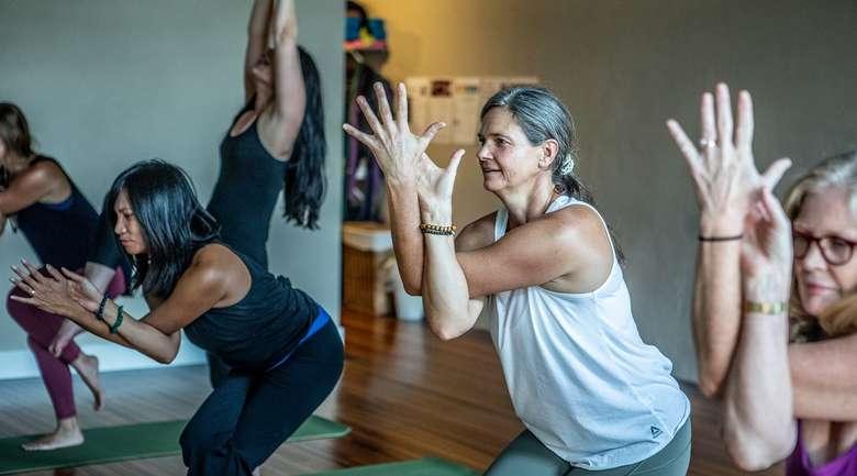 five women in a yoga class