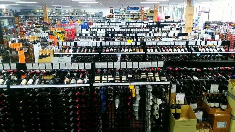 racks of wine in a liquor store