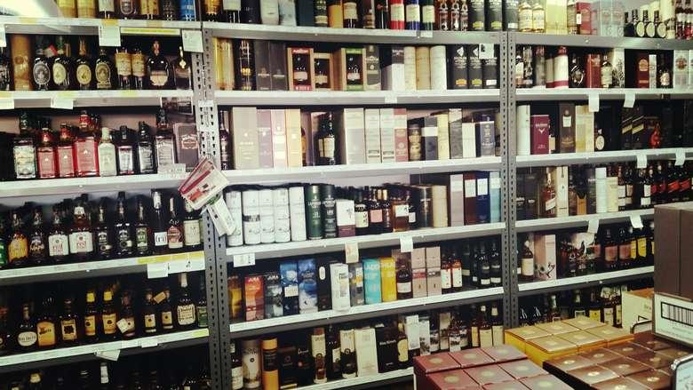 shelves full of spirits in a liquor store