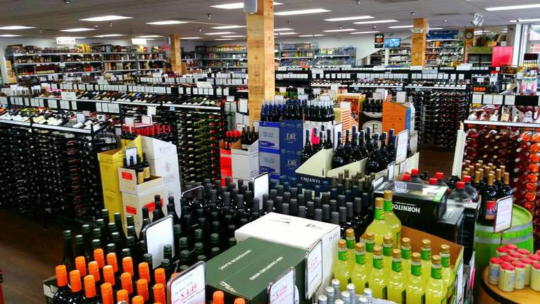 racks of wine and spirits in a liquor store