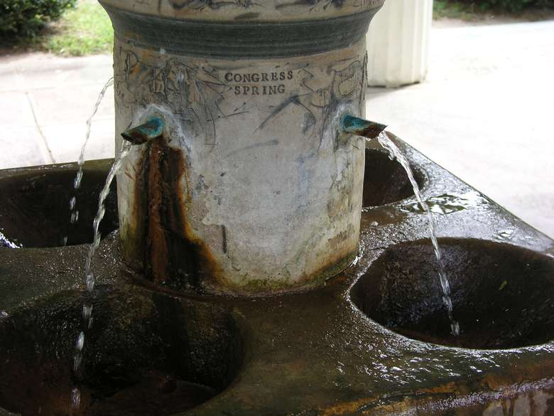 close-up view of congress spring shooting water into a basin