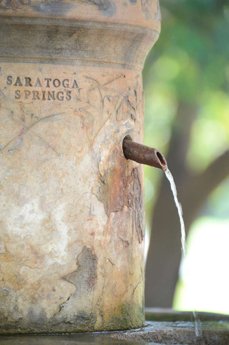 close-up view of saratoga springs etching on the side of congress spring