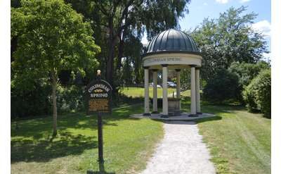 columbian spring sign and covered pavilion