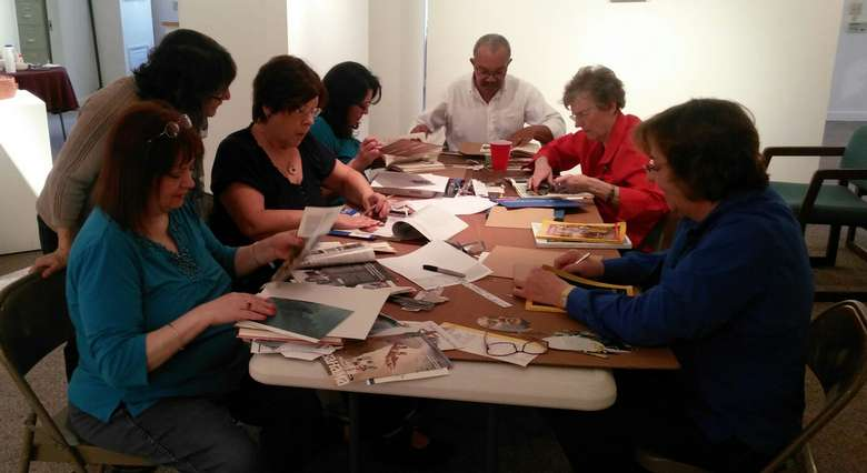 group of people participating in an altered book making workshop