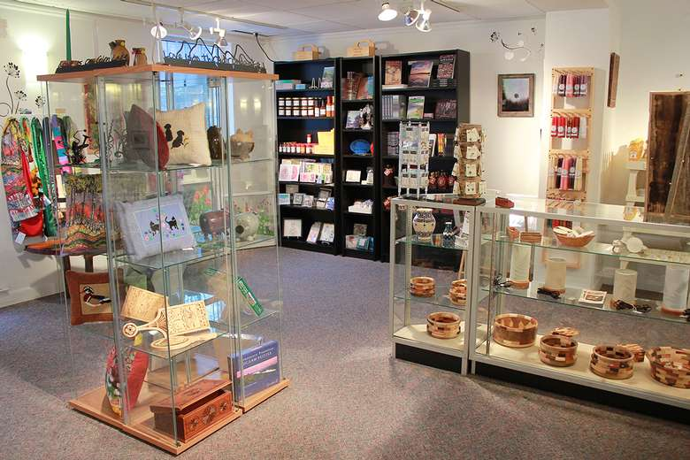 gift shop with items displayed on shelves and in glass cases
