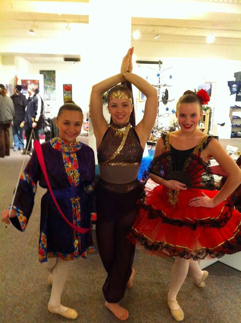 three dancers dressed to perform variations from the nutcracker