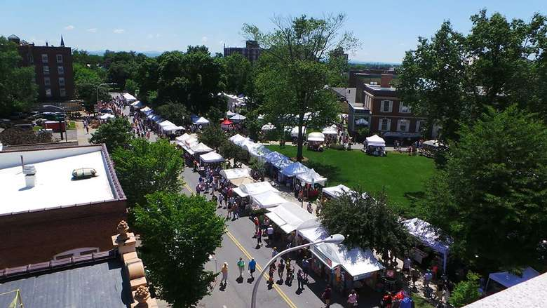 aerial view of vendor tents set up for an art festival