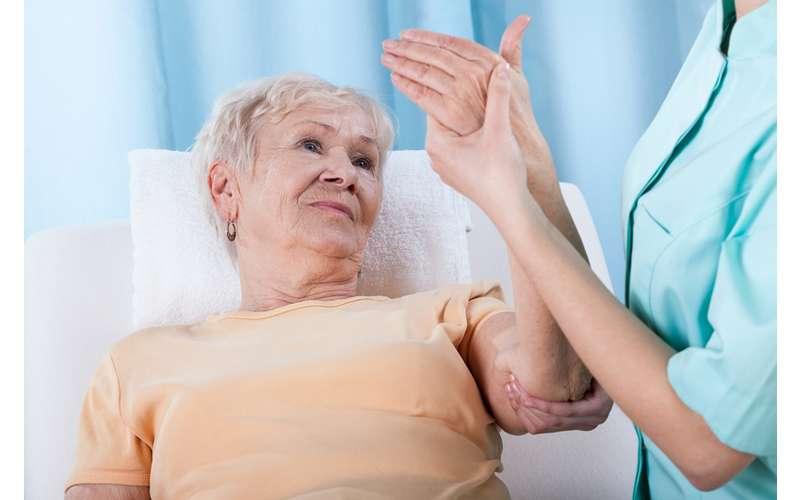 a nurse examining an elderly woman