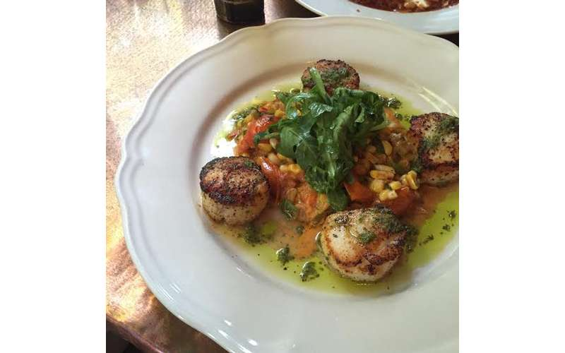 Pan seared jumbo sea scallops.