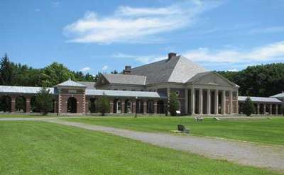 exterior of the hall of springs in saratoga spa state park with large columns in the front