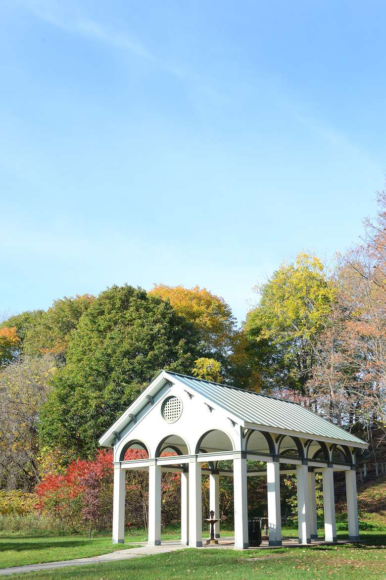 large white pavilion that protects governor and peerless springs on a sunny day in the fall