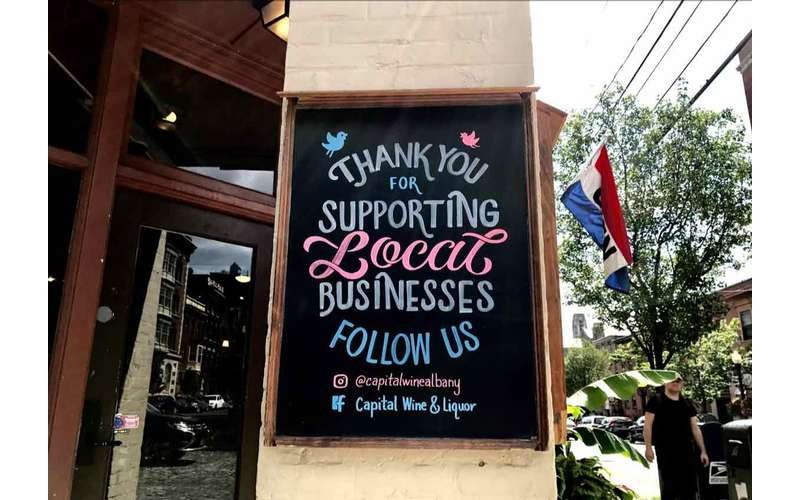 a sign saying thank you for supporting local businesses