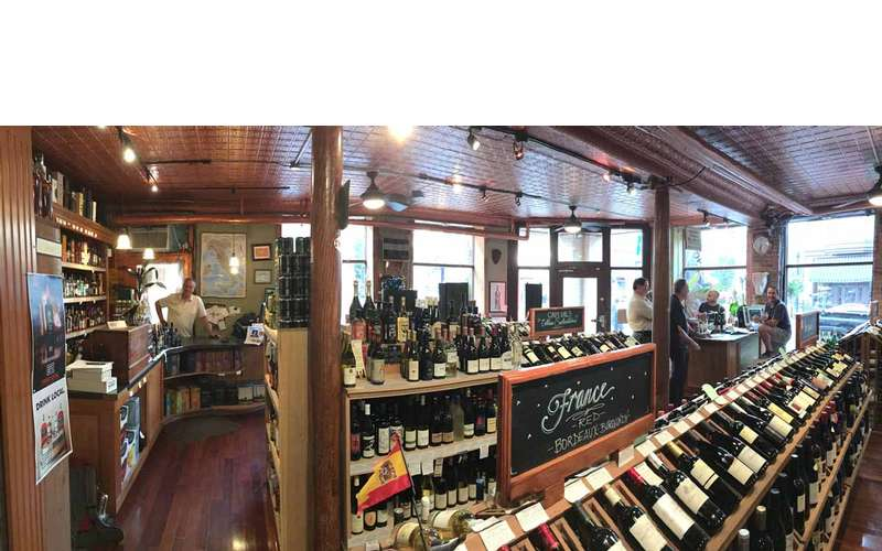 inside of wine store, staff at the counter ready to serve you
